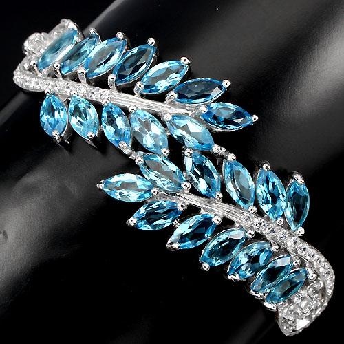 Жёсткий браслет с голубыми топазами