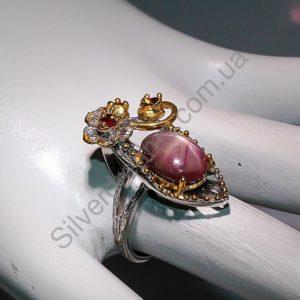 Серебряное кольцо со звёздчатым рубином и гранатами