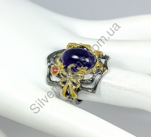 Авангардное серебряное кольцо с сапфиром