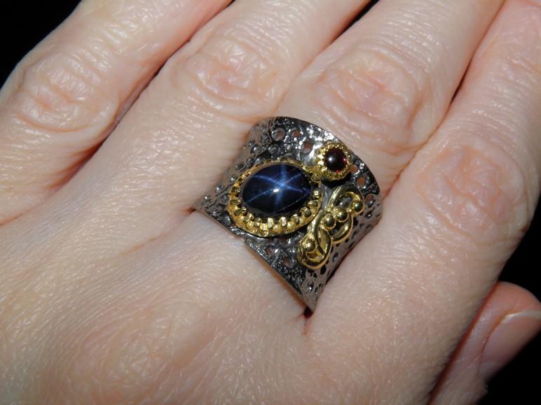 серебряное кольцо со знаком