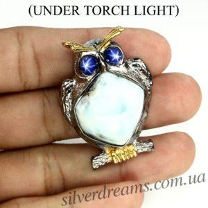 Серебряная брошь с ларимаром и звёздчатыми сапфирами