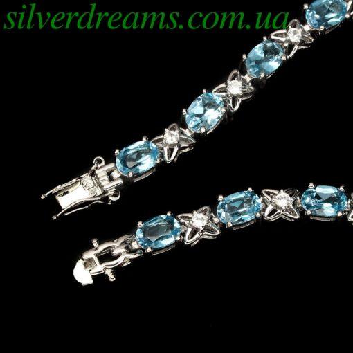 Серебряный браслет с голубыми топазами