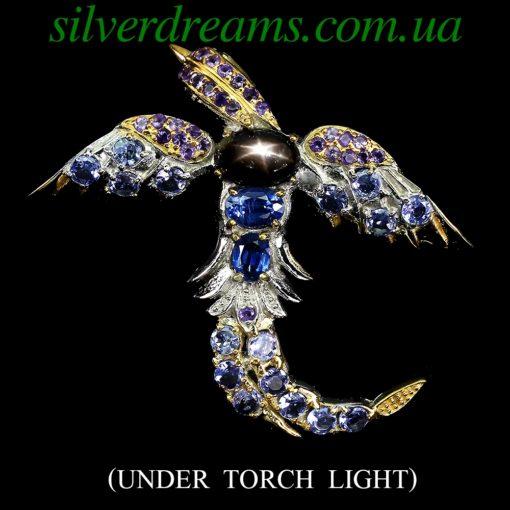 Серебряная брошь Птица с чёрным звёздчатым сапфиром и мульти